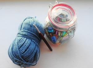 yarn, crochet hook, buttons